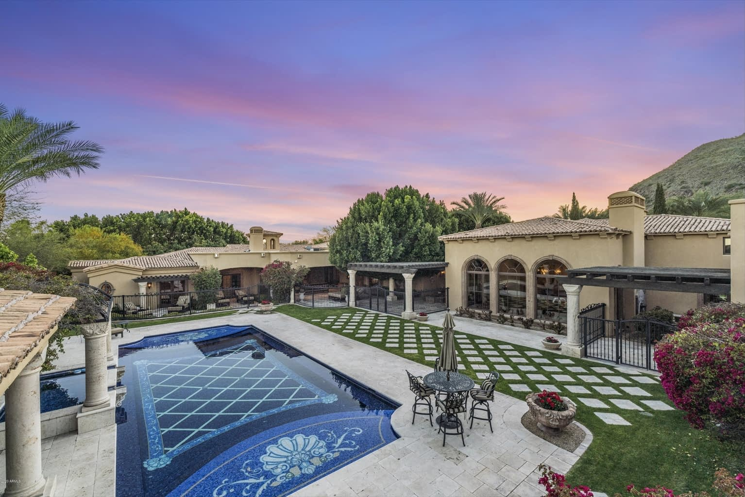 Luxury Mosaic Pool with Diamond shaped design on floor with outdoor Area