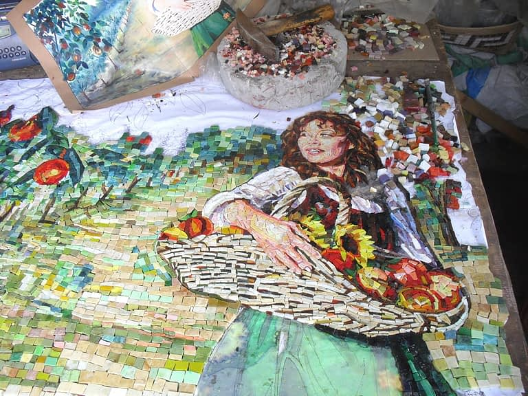 Kitchen backsplash mosaic of women walking through a Orchard work in progress