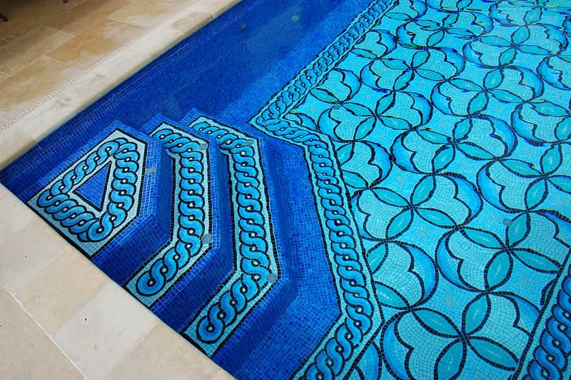In floor cleaning system on steps of mosaic pool